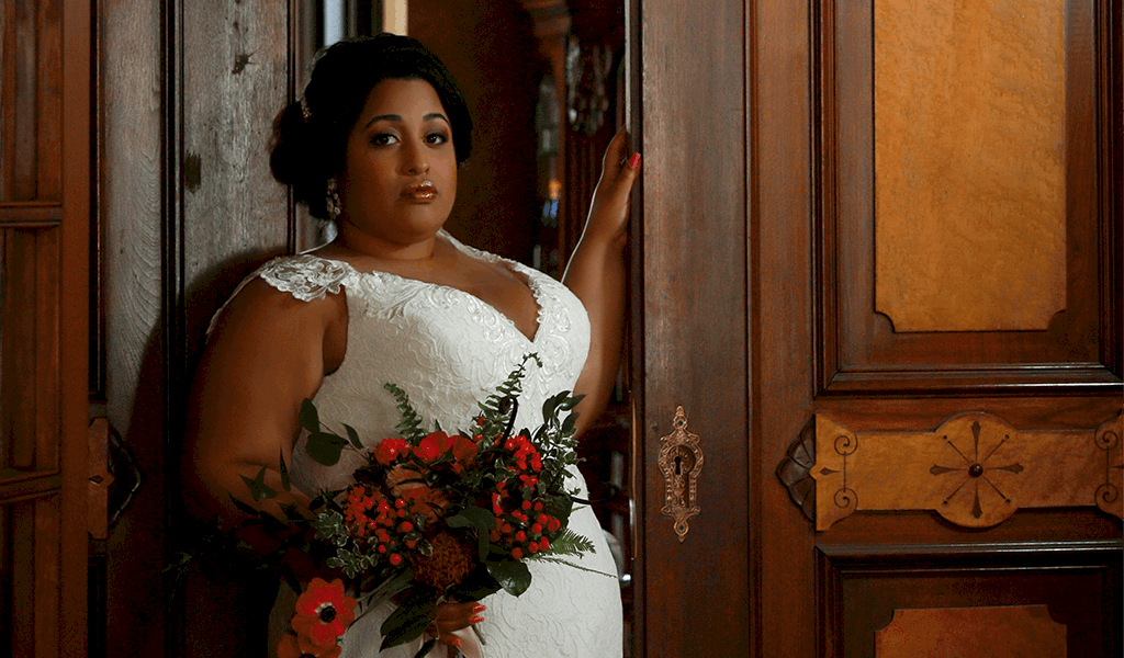 fitted plus-size wedding dress and florals